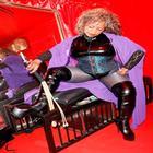 purple cape over latex bodice